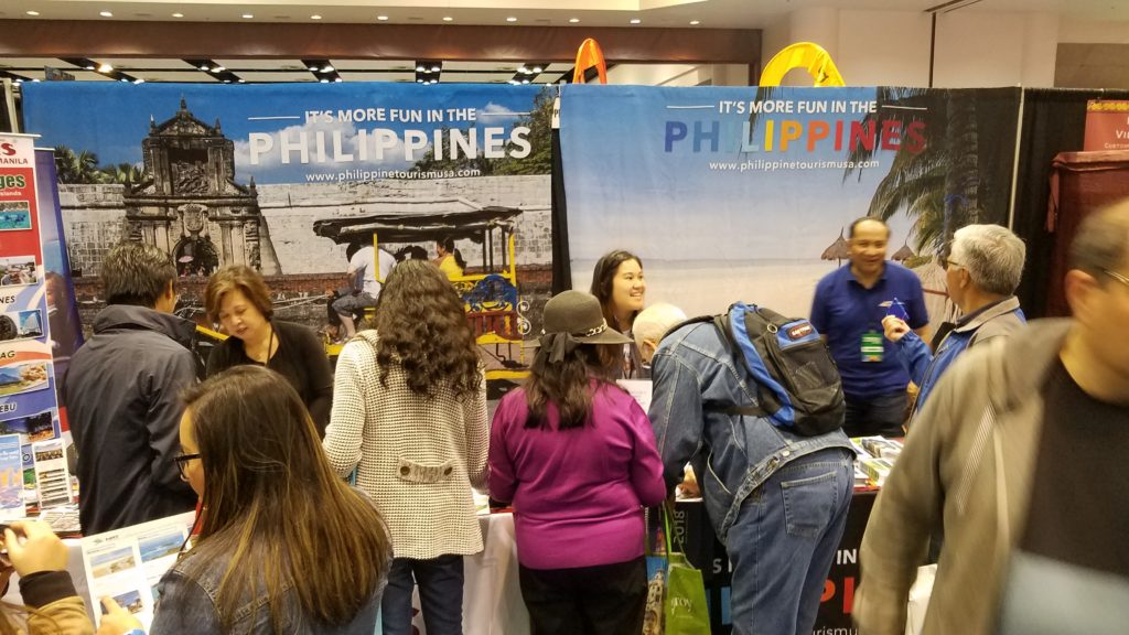 <photo> Non-stop inquiries, promo materials distribution and sign-ups at the Philippine tourism booth during the second day of the show